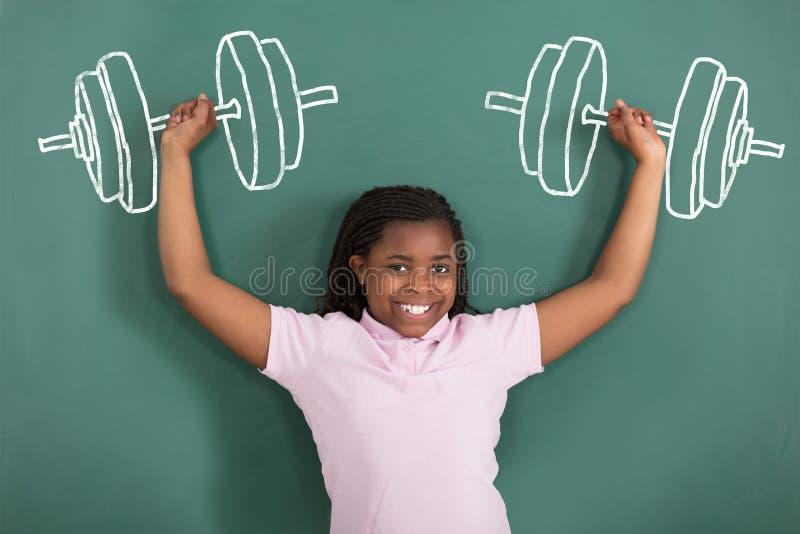 Smiling Girl Imaging Weightlifting stock photos