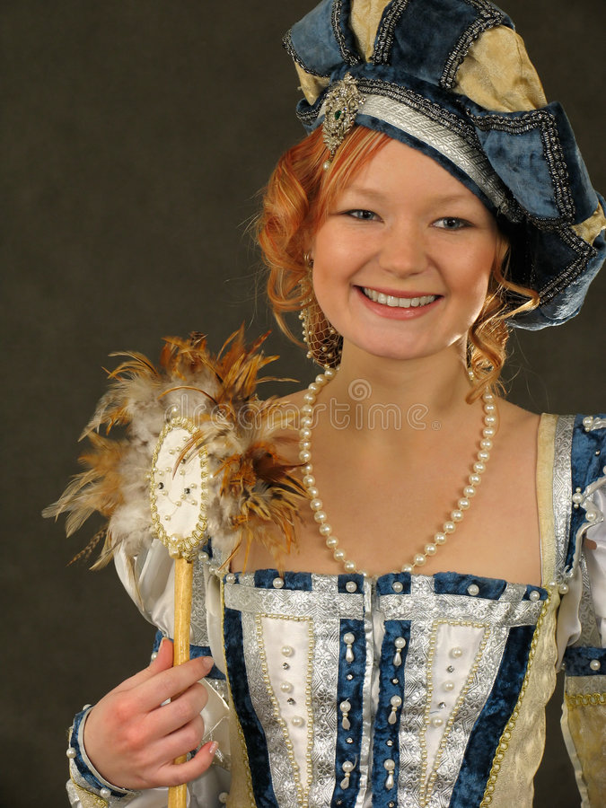 Free Smiling Girl In Polish Clothes Of 16 Century With Mirror-fan Royalty Free Stock Photography - 506947