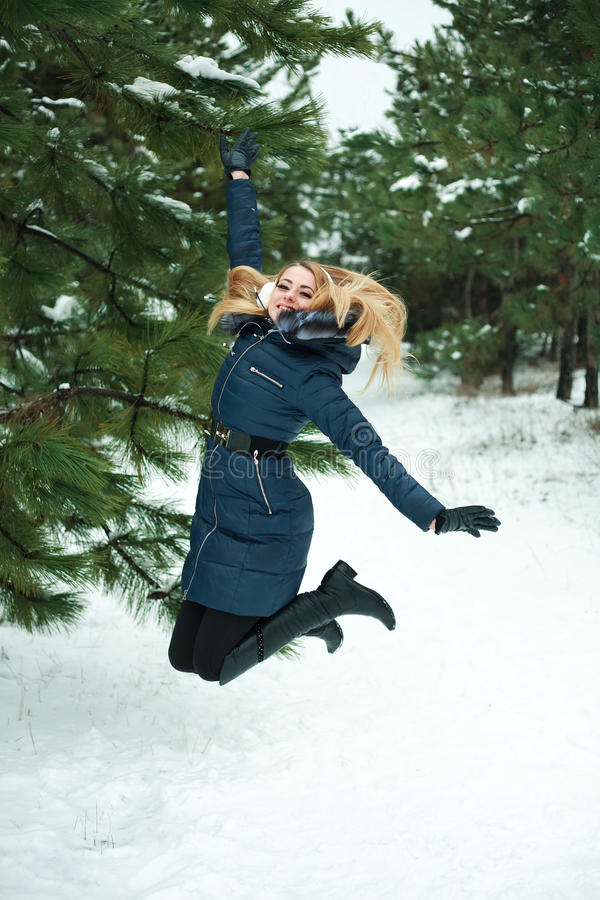 Download Smiling Girl Jumping In Pinewood Stock Photo - Image: 28768434