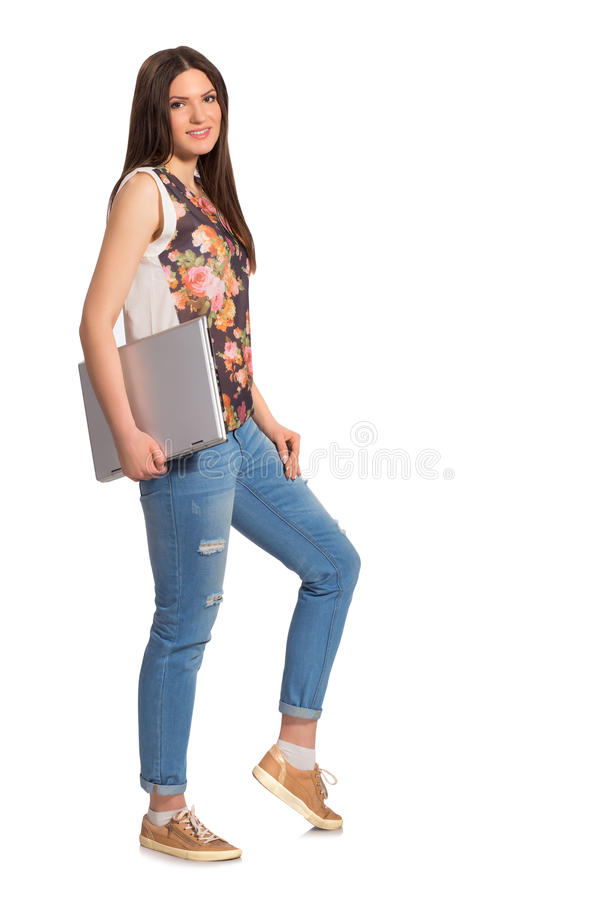 Smiling girl, with laptop full height stock photos