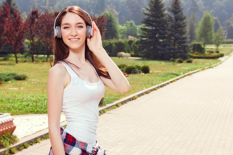 Smiling girl listening to music stock photography