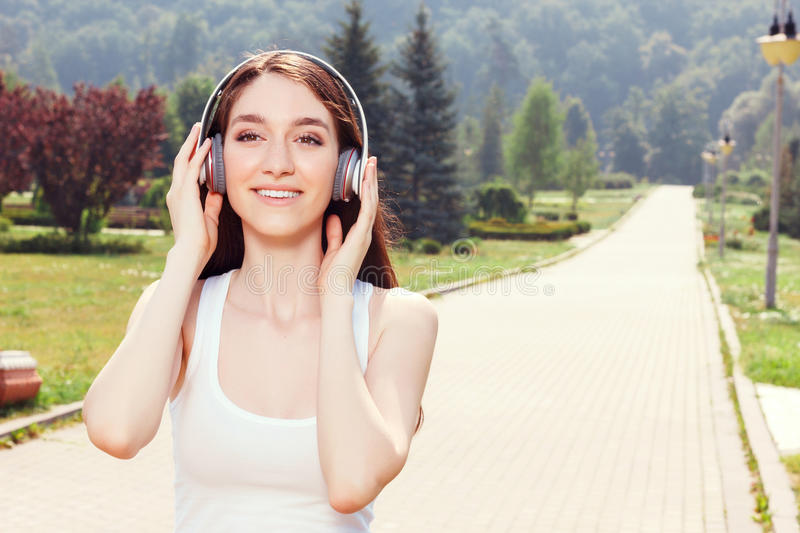 Smiling girl listening to music stock images
