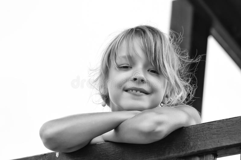 Smiling girl is looking stock image