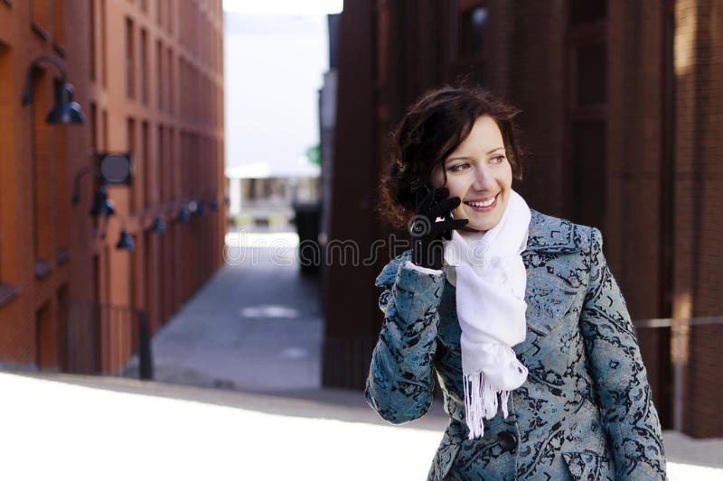 Download Smiling girl with a mobile stock image. Image of mobile - 24391029