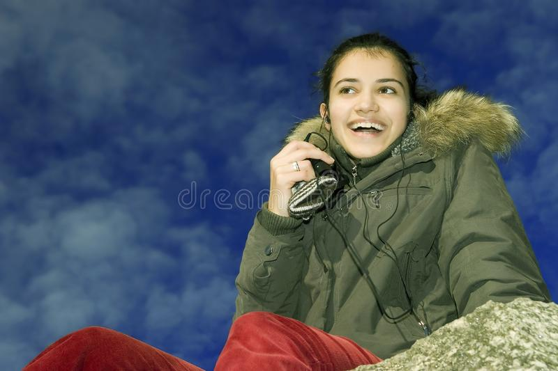 Download Smiling girl with mp3 stock photo. Image of leisure, headphones - 1779776