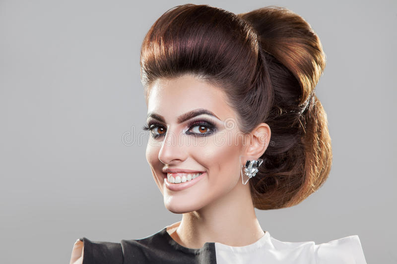 Smiling girl with nice elegant hairstyle looking at camera royalty free stock photography