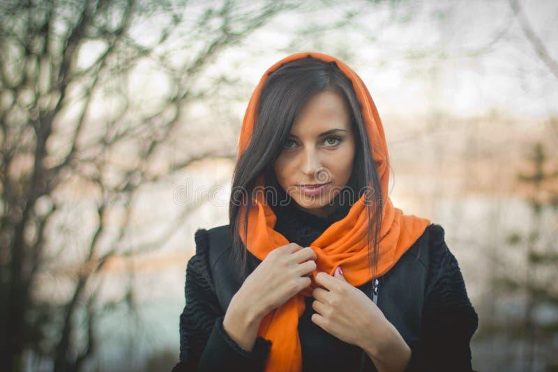 Smiling girl in orange hijab in Dubai Spring. Portrait of attractive woman stock image