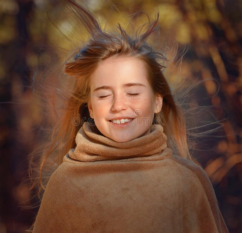 Smiling girl in outdoor portrait royalty free stock photo