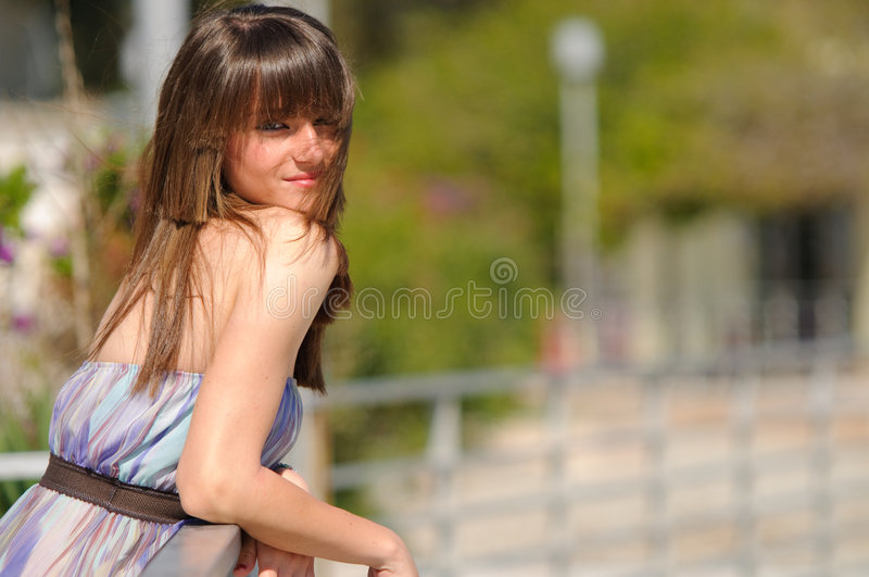 Smiling girl in the park royalty free stock photos