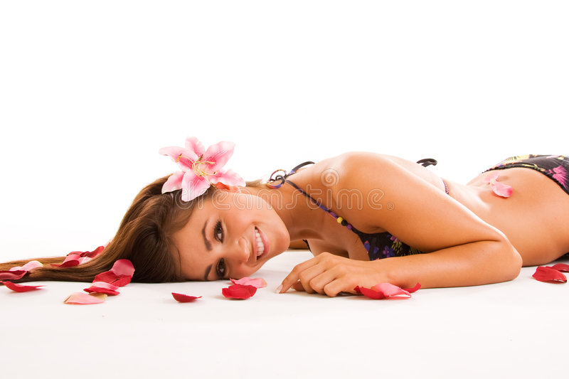 Smiling Girl in Petals royalty free stock images