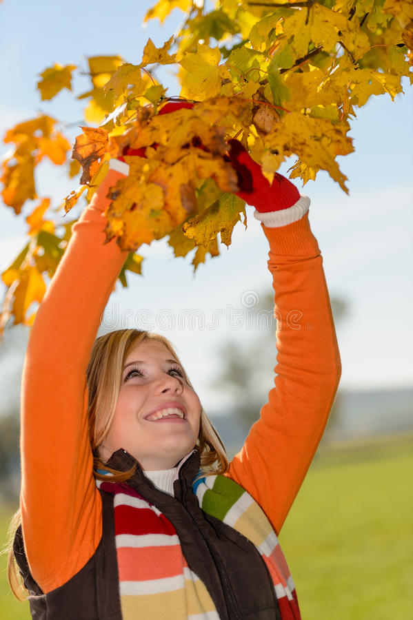 Download Smiling Girl Picking Dry Leaves Autumn Tree Stock Photo - Image of teenager, teen: 33547070