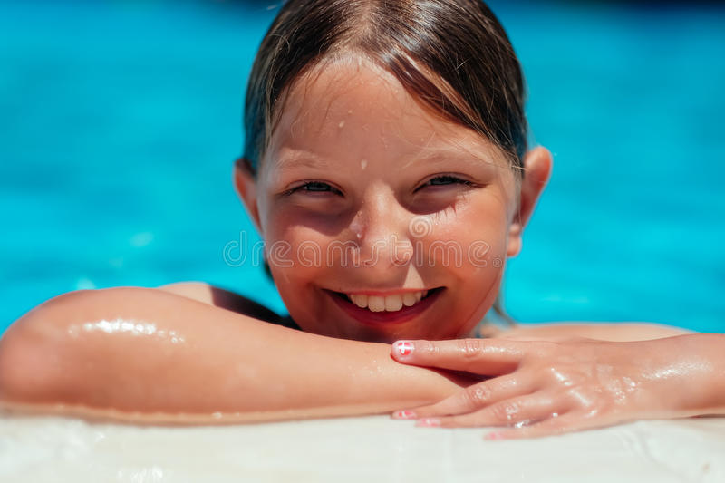 Smiling girl at poolside royalty free stock photos