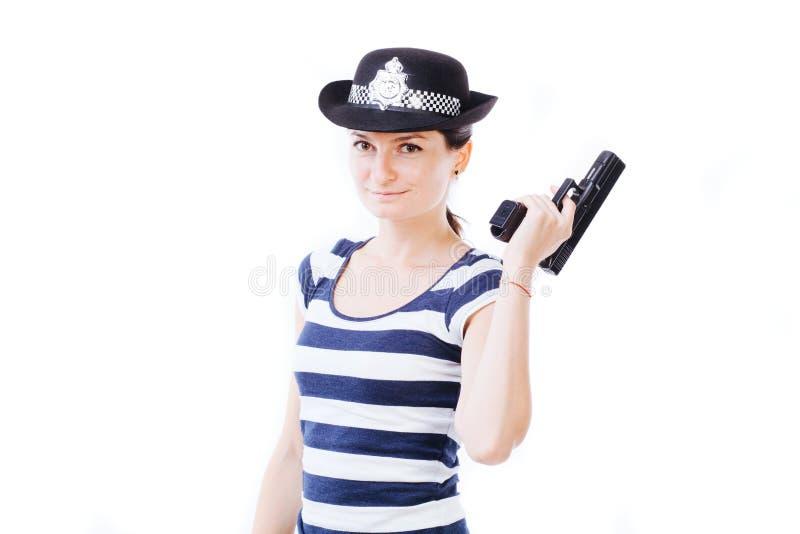 Smiling girl posing as policewoman stock images