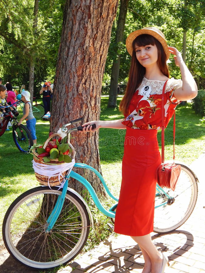 A smiling girl in red at the parade `Ladies on bikes royalty free stock photos