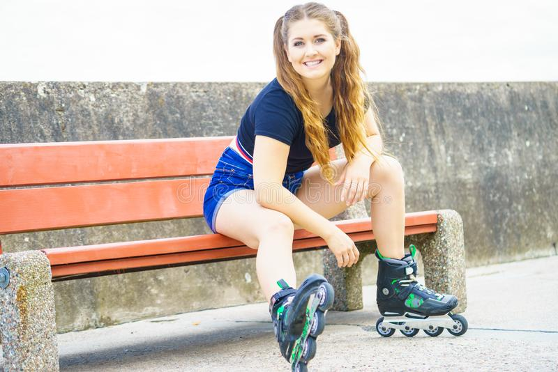 Smiling girl with roller skates outdoor royalty free stock photos