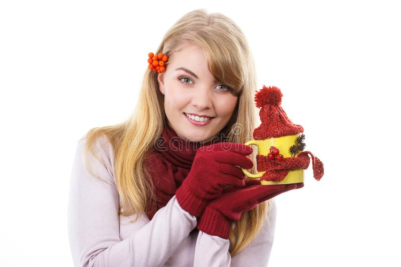 Smiling girl in gloves holding cup of tea with woolen scarf and cap stock photos