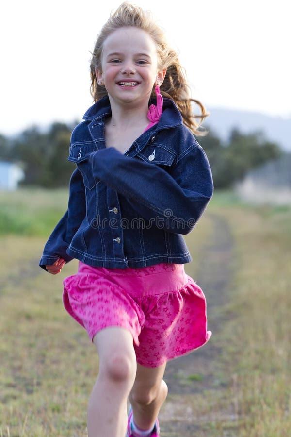 Smiling girl running royalty free stock images