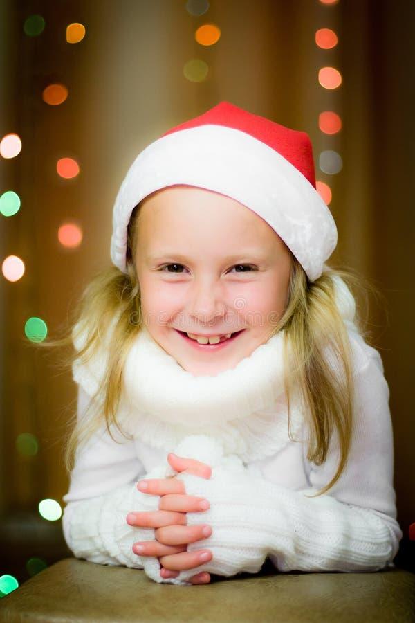 Download Smiling girl in santa hat stock photo. Image of december - 26835794