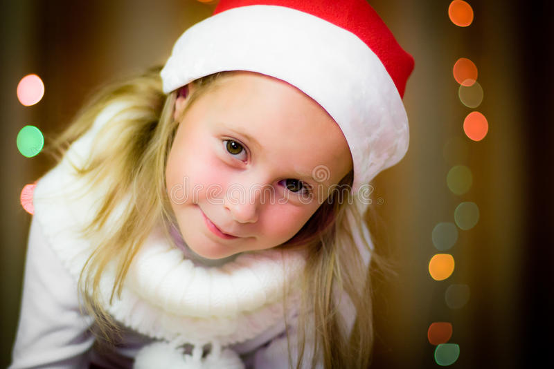 Download Smiling girl in santa hat stock image. Image of holiday - 26835813