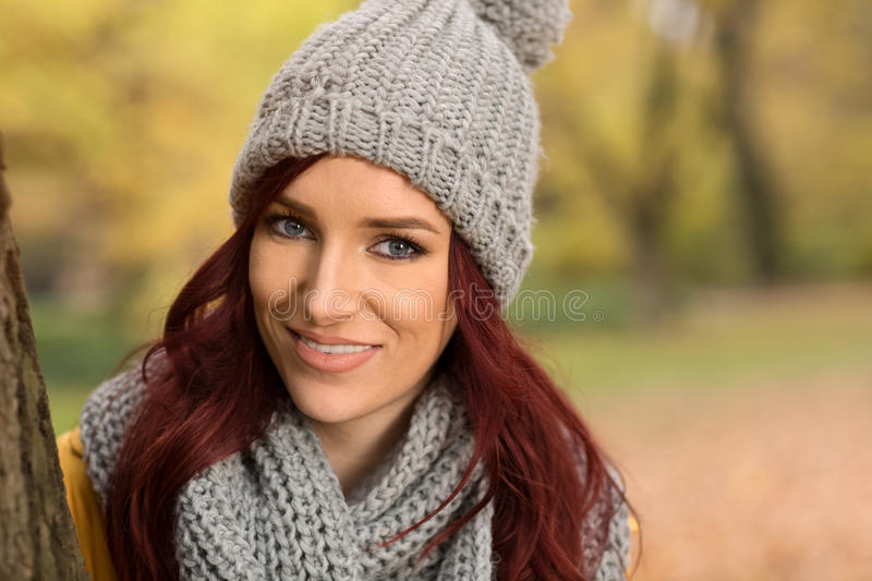 Smiling girl with scarf and cap stock images