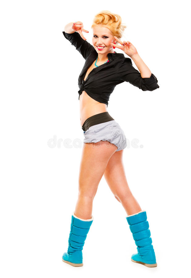 Smiling girl showing victory gesture. Full length portrait of standing in half-turn smiling girl showing victory gesture isolated on white stock images