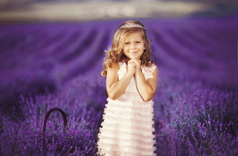 Download Smiling Girl Sniffing Flowers In A Lavender Field Stock Photo - Image: 36719482