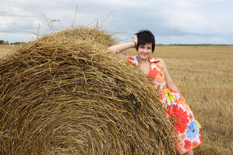 Download Smiling Girl At A Stack Of Straw Stock Image - Image: 10578373