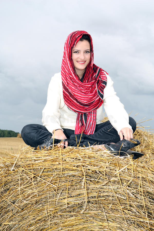 Download Smiling Girl On A Stack Of Straw Stock Image - Image: 10578933