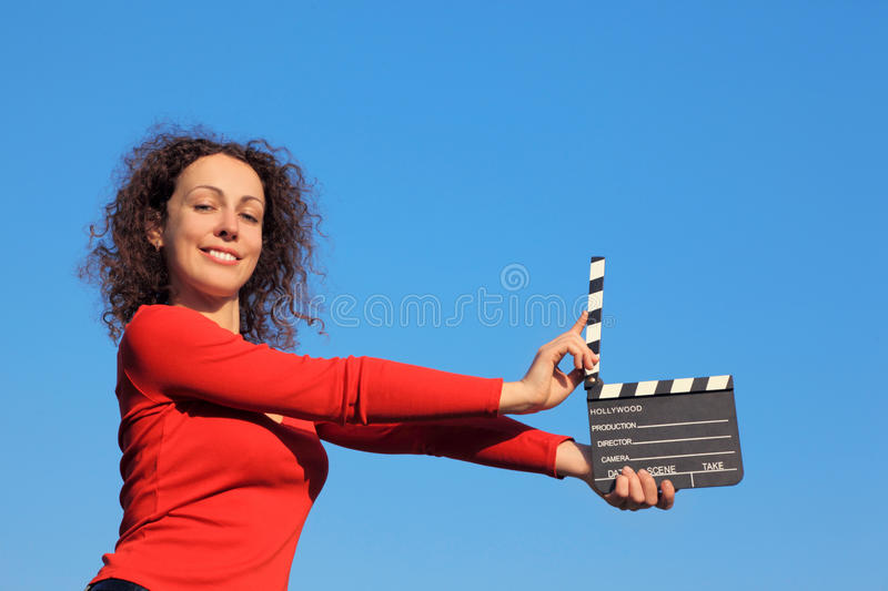 Download Smiling Girl Standing With Clapperboard Stock Photo - Image: 17889114