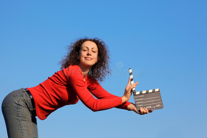 Download Smiling Girl Standing In Hands Clapperboard Stock Image - Image of clapstick, field: 17889107