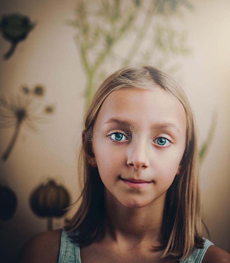 Smiling Girl Standing in White Painted Wall Room stock photos