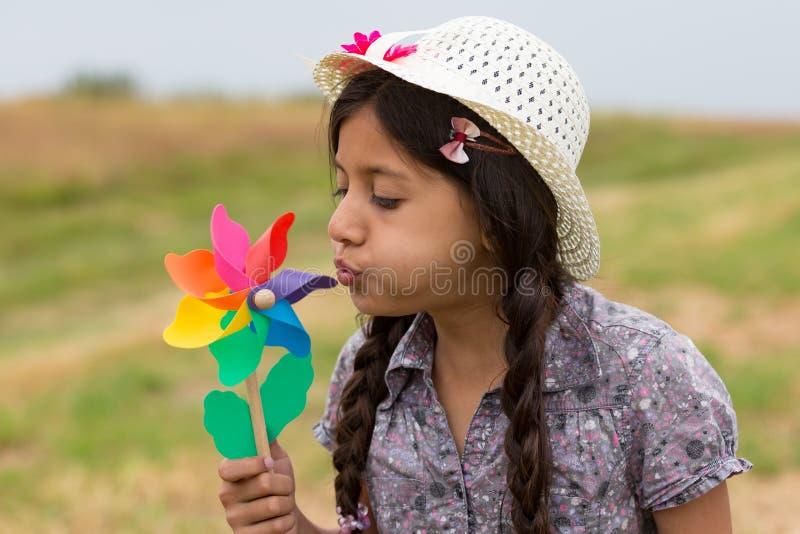 Smiling girl with pinwheel royalty free stock photography