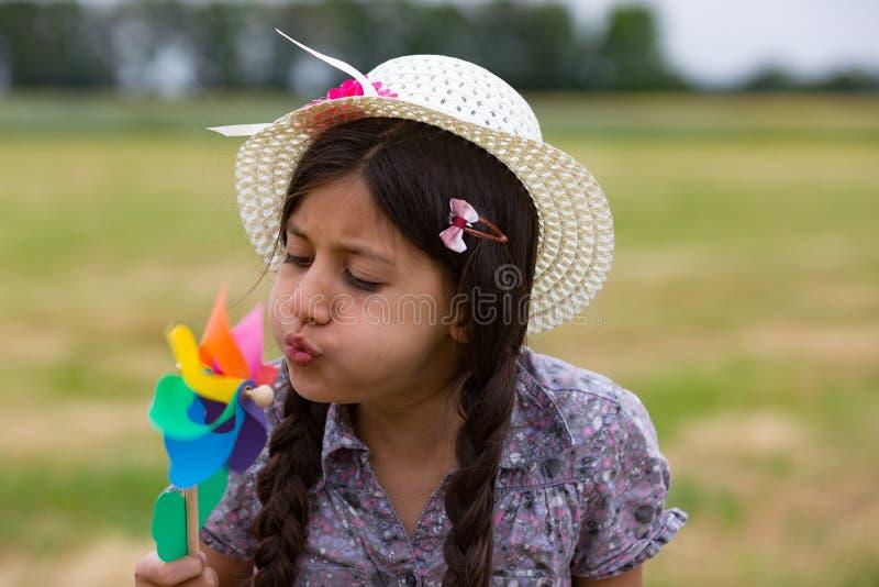Smiling girl with pinwheel stock photo