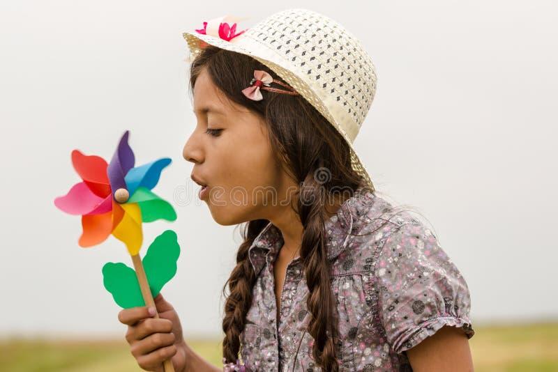 Smiling girl with pinwheel stock photography