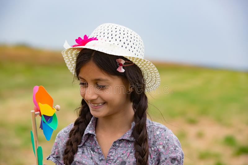 Smiling girl with pinwheel royalty free stock images