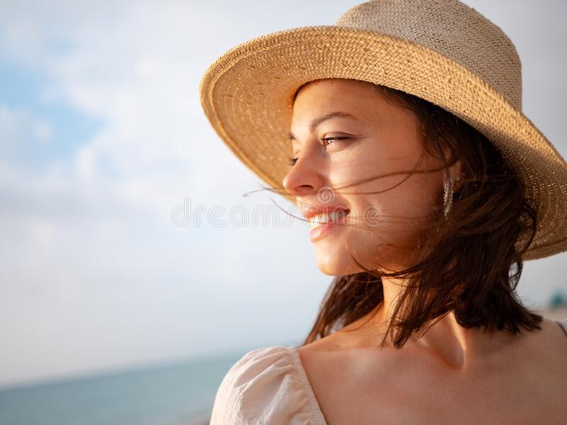 Smiling girl in the sun stock images