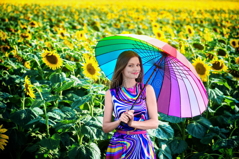 Smiling girl in the sunflower fields royalty free stock image
