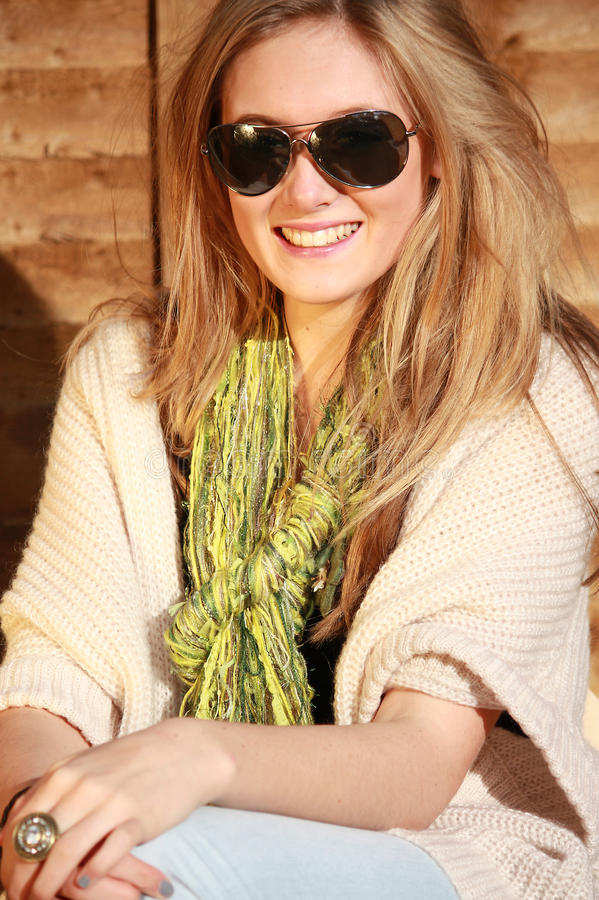 Smiling girl in sunglasses stock photos