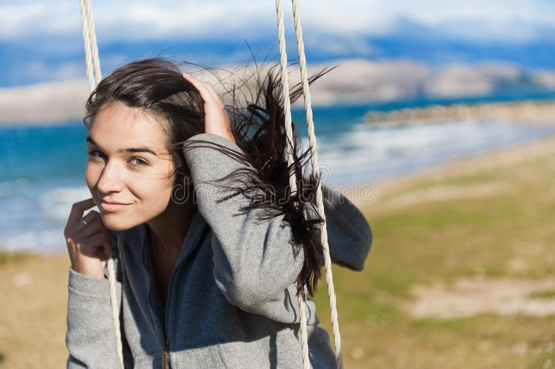 Smiling girl on a swing. Photo taken during holidays in Croatia royalty free stock image