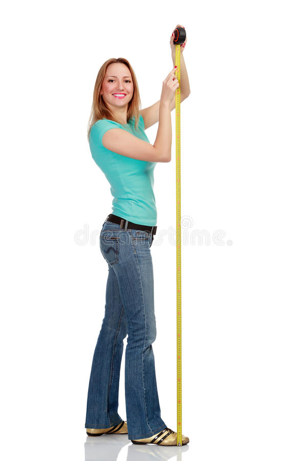 Smiling girl with a tape measure royalty free stock image