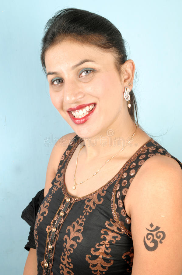 Smiling girl with tattoo stock photography