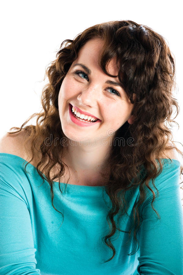 Smiling girl in turquoise, smiling and glancing royalty free stock photos