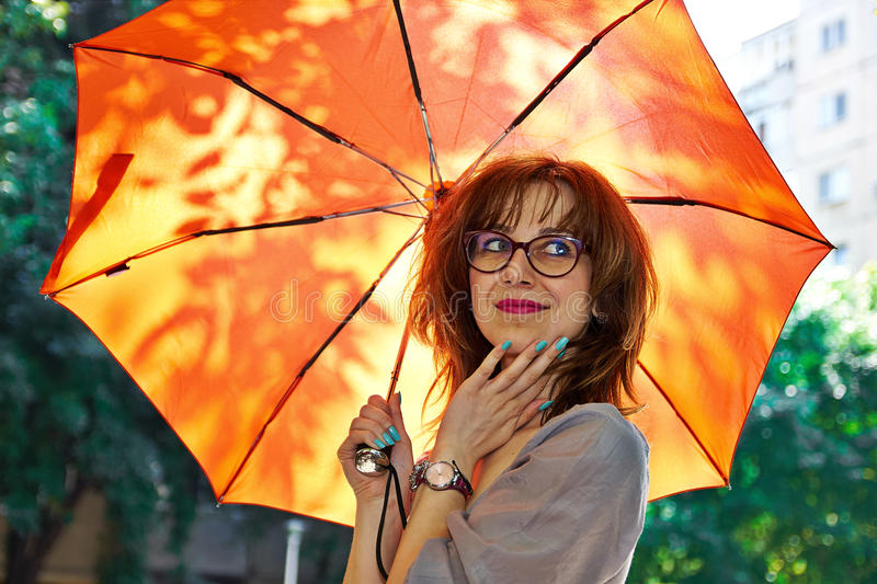 Smiling girl with umbrella royalty free stock images