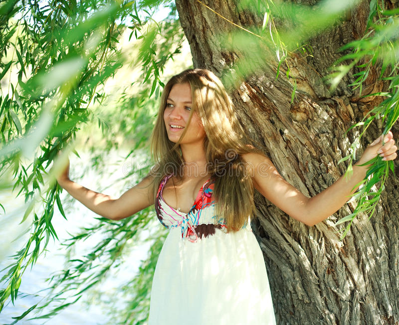 Download Smiling Girl Under Willow Tree Stock Image - Image: 25740753