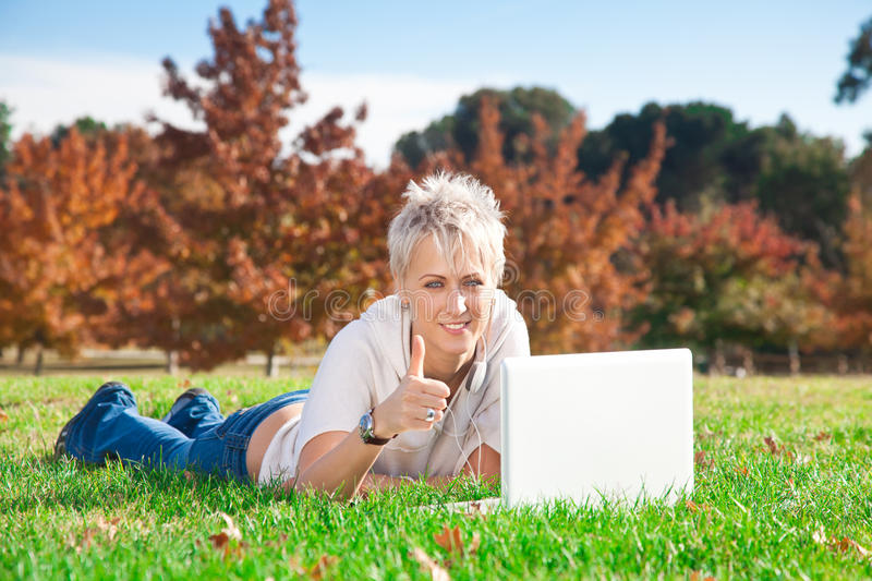 Download Smiling Girl Using Laptop Outdoors Stock Images - Image: 22154994