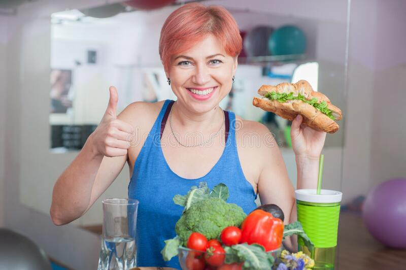 Smiling girl with vegan croissant, healthy lifestyle, weight loss stock image