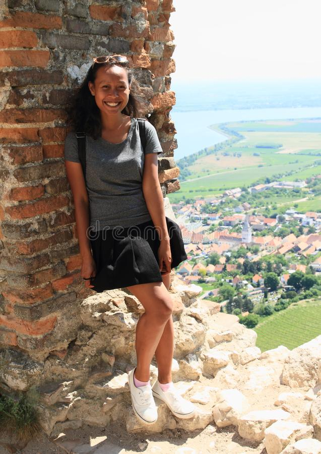 Smiling girl on view from Castle Devicky on Palava stock image