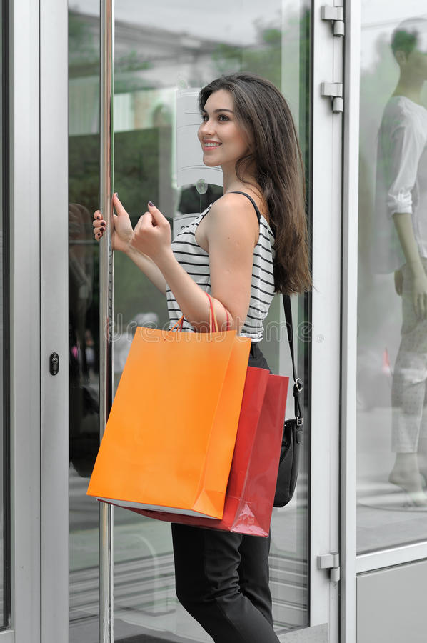 Smiling Girl Walks Into A Glass Door Shop Stock Photo Image Of