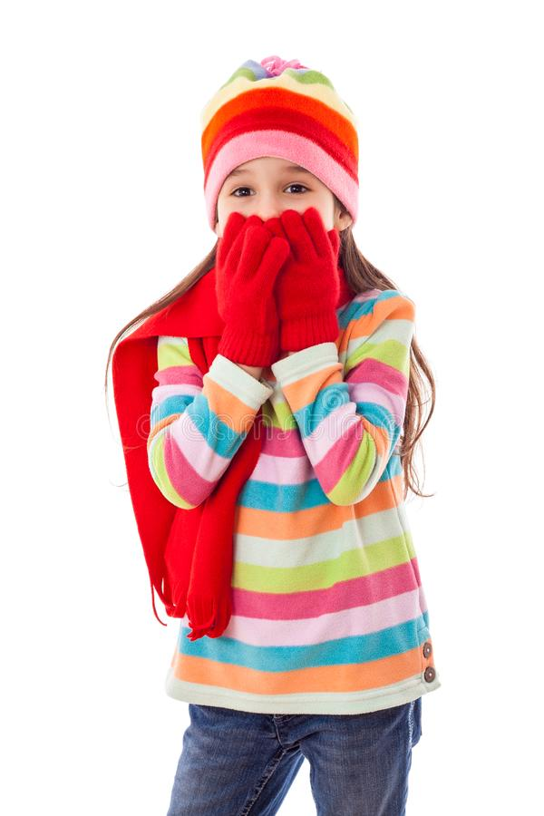 Smiling girl in warm winter clothes royalty free stock photos