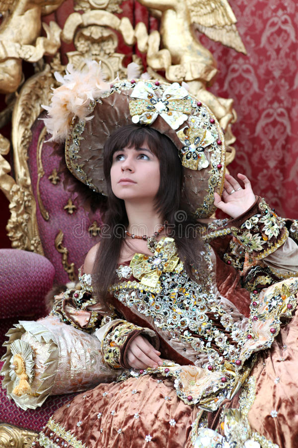 Smiling girl wearing an antique princess dress stock image